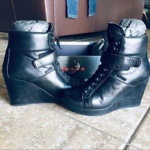 Prada boots on platform in original box.